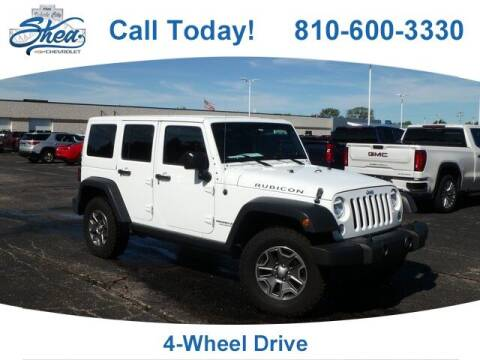 2016 Jeep Wrangler Unlimited for sale at Erick's Used Car Factory in Flint MI