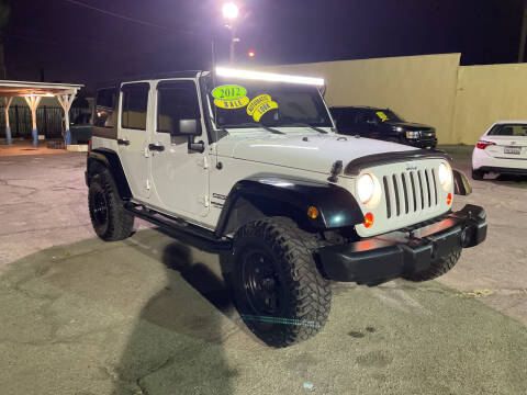 2012 Jeep Wrangler Unlimited for sale at JR'S AUTO SALES in Pacoima CA