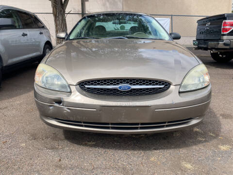 2003 Ford Taurus for sale at GO GREEN MOTORS in Lakewood CO