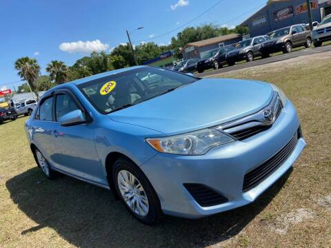 2012 Toyota Camry for sale at Unique Motor Sport Sales in Kissimmee FL