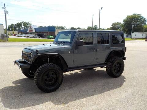2014 Jeep Wrangler Unlimited for sale at Young's Motor Company Inc. in Benson NC
