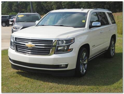 2015 Chevrolet Tahoe for sale at STRICKLAND AUTO GROUP INC in Ahoskie NC