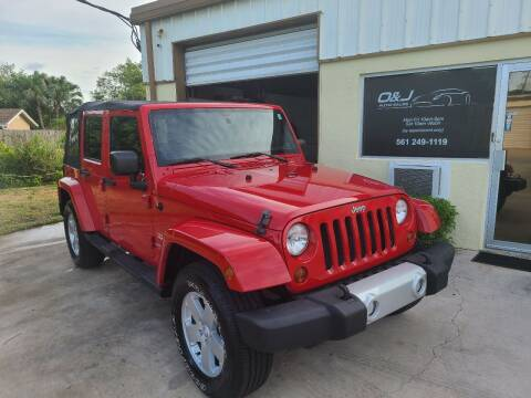 2011 Jeep Wrangler Unlimited for sale at O & J Auto Sales in Royal Palm Beach FL