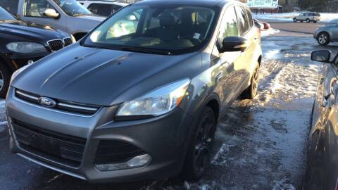 2013 Ford Escape for sale at BELOW BOOK AUTO SALES in Idaho Falls ID