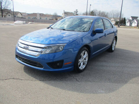 2012 Ford Fusion for sale at Triangle Auto Sales in Elgin IL