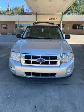 2010 Ford Escape for sale at Dalia Motors LLC in Winder GA