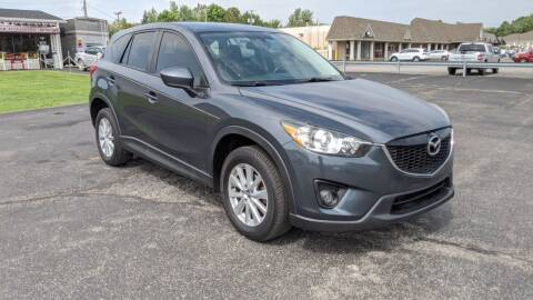 2013 Mazda CX-5 for sale at Newport Auto Group in Austintown OH