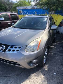 2013 Nissan Rogue for sale at H.A. Twins Corp in Miami FL