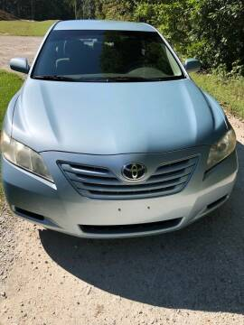 2009 Toyota Camry for sale at Doyle's Auto Sales and Service in North Vernon IN