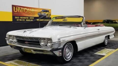 1961 Oldsmobile Starfire for sale at UNIQUE SPECIALTY & CLASSICS in Mankato MN