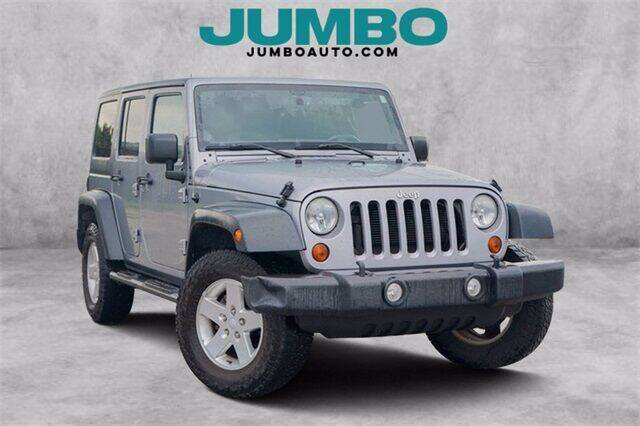 2013 Jeep Wrangler Unlimited for sale at Jumbo Auto & Truck Plaza in Hollywood FL