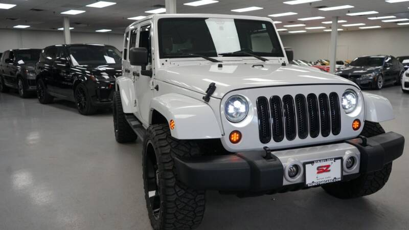 2012 Jeep Wrangler Unlimited for sale at SZ Motorcars in Woodbury NY