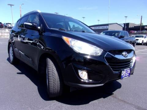 2012 Hyundai Tucson for sale at Delta Auto Sales in Milwaukie OR