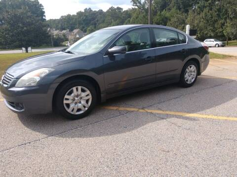 2009 Nissan Altima for sale at WIGGLES AUTO SALES INC in Mableton GA