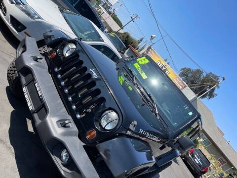 2013 Jeep Wrangler Unlimited for sale at Rey's Auto Sales in Stockton CA