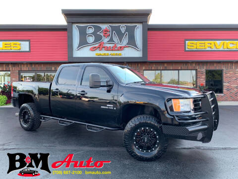 2009 GMC Sierra 2500HD for sale at B & M Auto Sales Inc. in Oak Forest IL