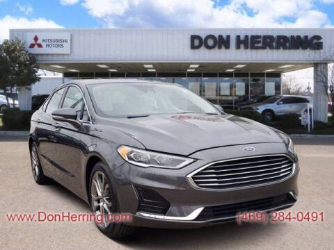 2019 Ford Fusion for sale at Don Herring Mitsubishi in Dallas TX