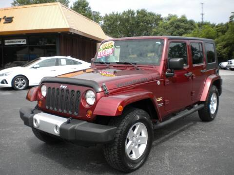 2010 Jeep Wrangler Unlimited for sale at Houser & Son Auto Sales in Blountville TN