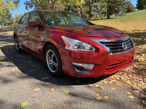 2015 Nissan Altima for sale at BELOW BOOK AUTO SALES in Idaho Falls ID