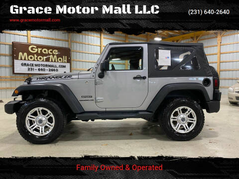 2015 Jeep Wrangler for sale at Grace Motor Mall LLC in Traverse City MI