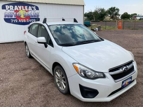 2014 Subaru Impreza for sale at Praylea's Auto Sales in Peyton CO