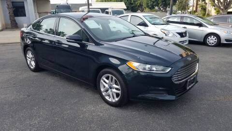 2014 Ford Fusion for sale at In-House Auto Finance in Hawthorne CA