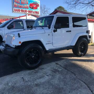 2013 Jeep Wrangler for sale at D. C.  Autos in Huntsville AL