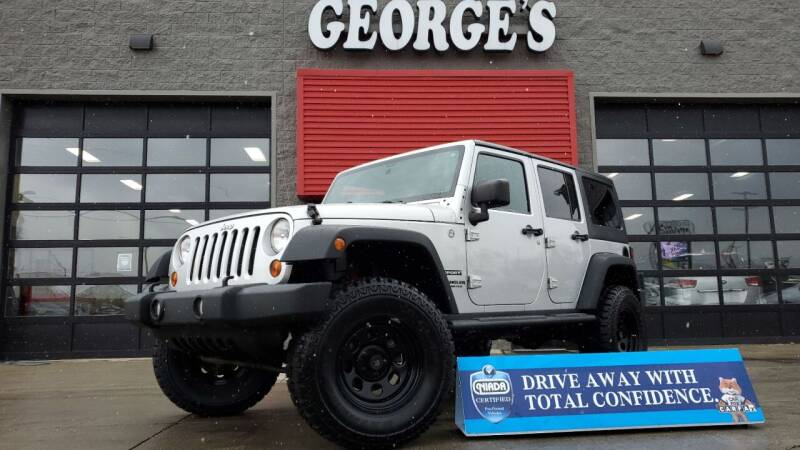 2012 Jeep Wrangler Unlimited for sale at George's Used Cars - Telegraph in Brownstown MI
