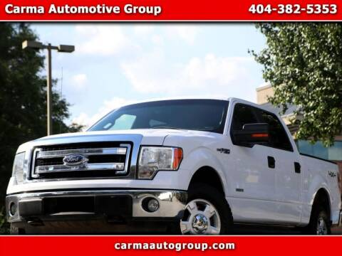 2014 Ford F-150 for sale at Carma Auto Group in Duluth GA