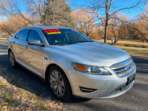 2011 Ford Taurus for sale at BELOW BOOK AUTO SALES in Idaho Falls ID