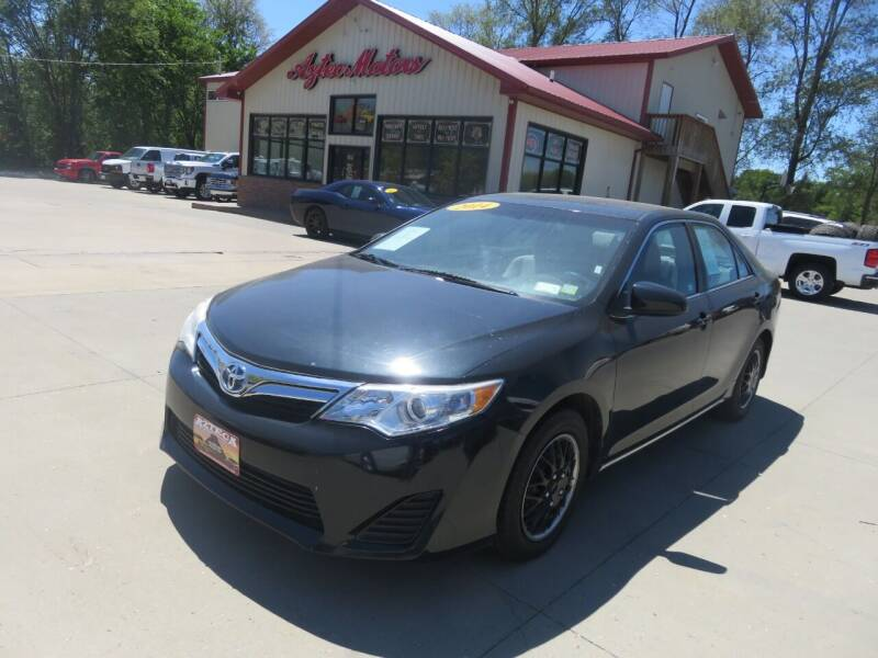 2014 Toyota Camry for sale at Azteca Auto Sales LLC in Des Moines IA