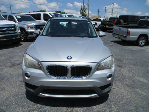 2014 BMW X1 for sale at LOS PAISANOS AUTO & TRUCK SALES LLC in Doraville GA