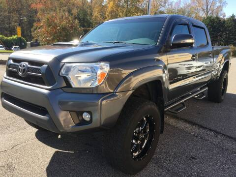 2014 Toyota Tacoma for sale at Highlands Luxury Cars, Inc. in Marietta GA