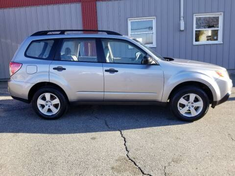 2010 Subaru Forester for sale at Howe's Auto Sales in Lowell MA