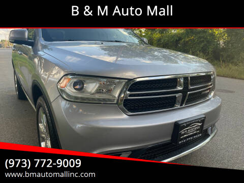 2014 Dodge Durango for sale at B & M Auto Mall in Clifton NJ