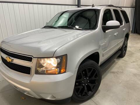 2013 Chevrolet Tahoe for sale at EUROPEAN AUTOHAUS, LLC in Holland MI