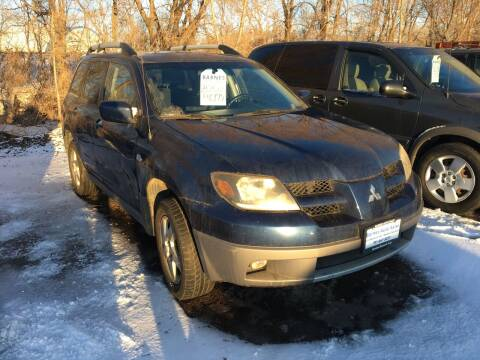 2003 Mitsubishi Outlander for sale at BARNES AUTO SALES in Mandan ND