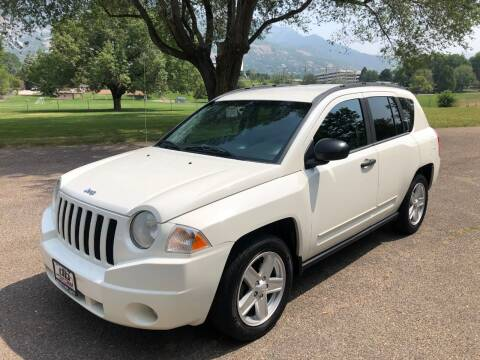 2010 Jeep Compass for sale at DRIVE N BUY AUTO SALES in Ogden UT