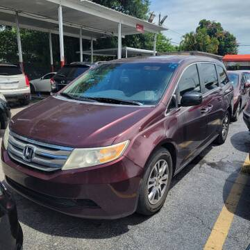 2012 Honda Odyssey for sale at America Auto Wholesale Inc in Miami FL