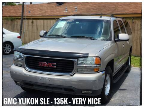 2004 GMC Yukon XL for sale at ASTRO MOTORS in Houston TX