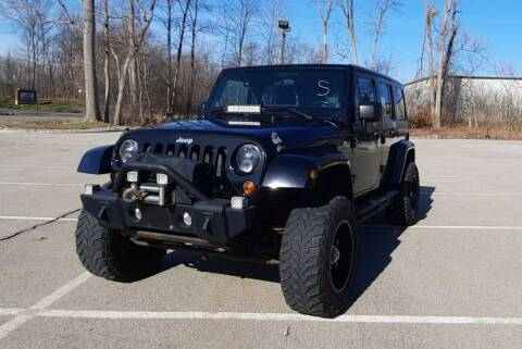 2011 Jeep Wrangler Unlimited for sale at J & J Used Auto in Jackson MI