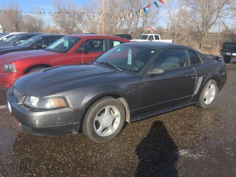 2004 Ford Mustang for sale at BARNES AUTO SALES in Mandan ND