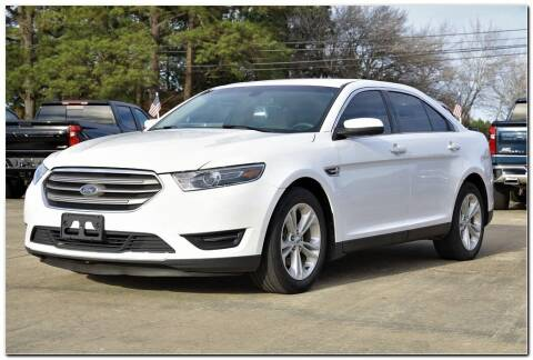 2018 Ford Taurus for sale at STRICKLAND AUTO GROUP INC in Ahoskie NC