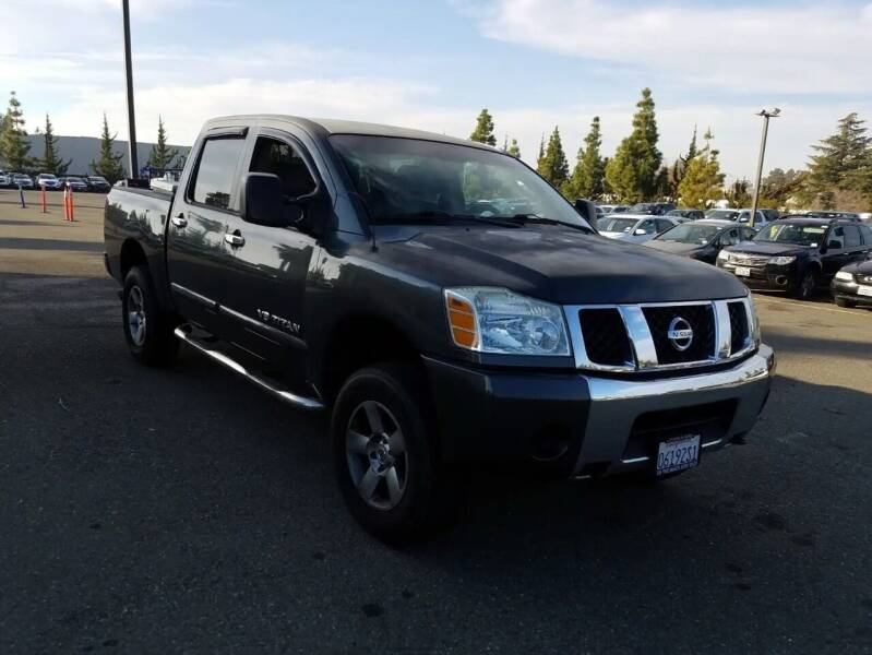 2006 Nissan Titan for sale at MCHENRY AUTO SALES in Modesto CA