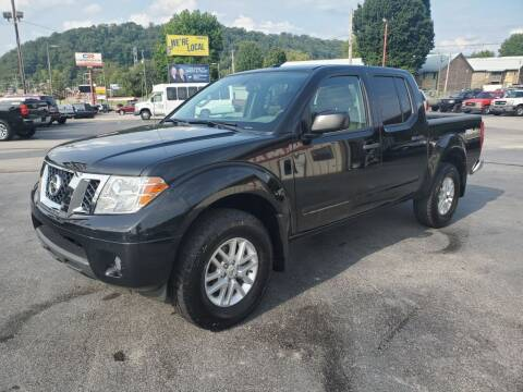 2014 Nissan Frontier for sale at MCMANUS AUTO SALES in Knoxville TN