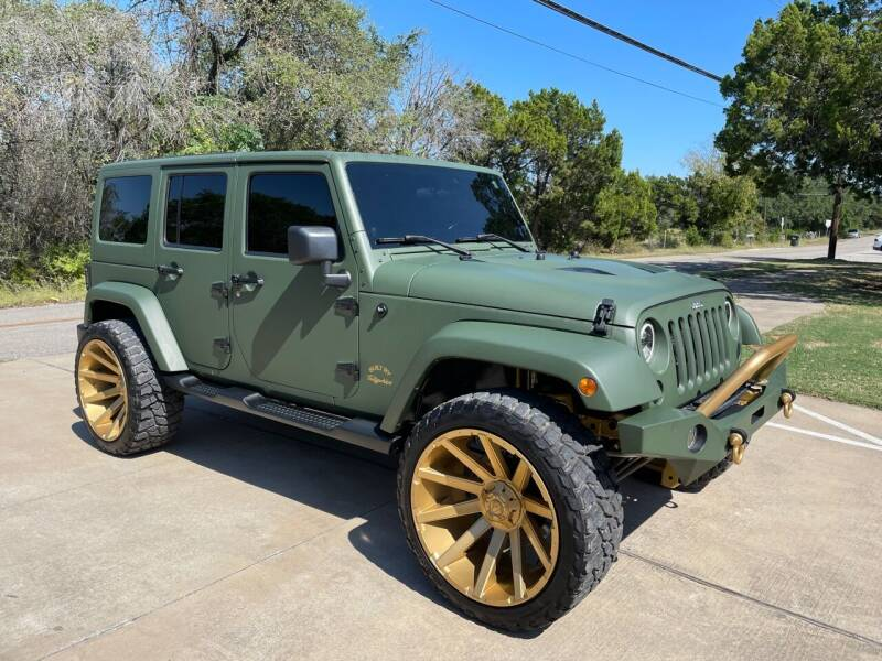 2012 Jeep Wrangler Unlimited for sale at Luxury Motorsports in Austin TX