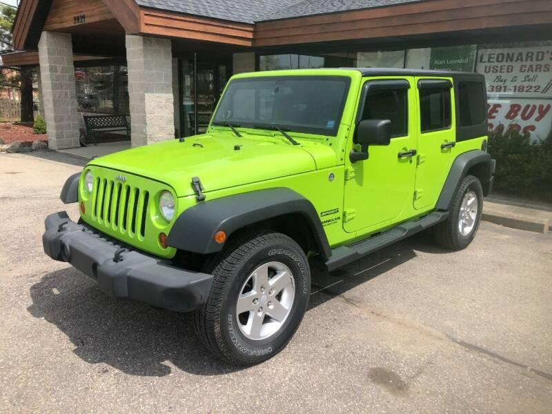 2013 Jeep Wrangler Unlimited for sale at Leonard Enterprise Used Cars in Orion MI