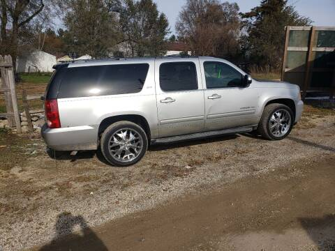 2010 GMC Yukon XL for sale at Northwoods Auto & Truck Sales in Machesney Park IL
