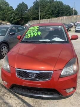 2010 Kia Rio for sale at J D USED AUTO SALES INC in Doraville GA