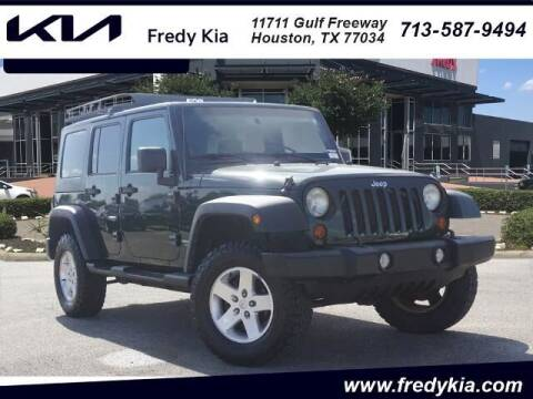 2010 Jeep Wrangler Unlimited for sale at FREDY KIA USED CARS in Houston TX